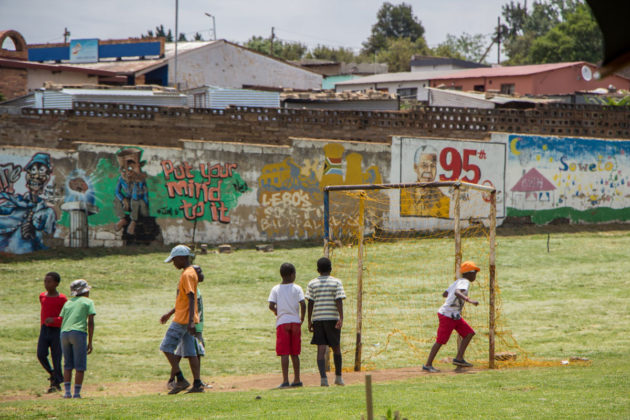 Kids playing football in Soweto