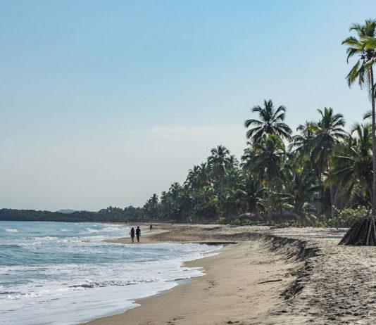 Spazieren gehen am Strand von Palomino